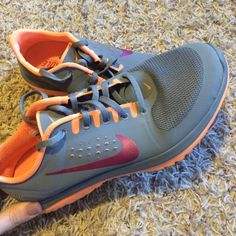 Nike running shoes Grey and orange Nike fit sole  running shoes. Worn only twice Nike Shoes Athletic Shoes