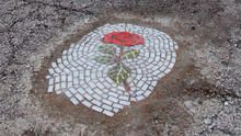 Pothole mosaics: Street art that fills a need
