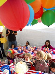Punching balloons for giant paper mache hot air balloon combined class idea