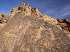 """Rock Art in the Hail Region of Saudi Arabia """"This site includes two components: Jabel Umm Sinman at Jubbah and the Jabal al-Manjor and Raat at Shuwaymis. A lake once situated at the foot of the Umm Sinman hill range that has now disappeared used to be a source of fresh water for people and animals in the southern part of the Great Narfoud Desert. The ancestors of today's Arab populations have left traces of their passages in numerous petroglyphs and inscriptions on the rock face."""