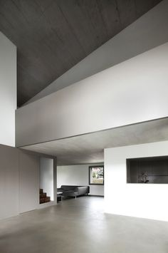 Interior in dhades of grey. Haus An Der Reuss by Dolmus Architekten.