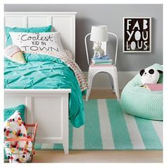 Keep this kids' getaway ultra-cool with clean white furniture and lots of turquoise, from the comforter to rug to bean bag chair. Then add in pops of color, like ice cream sheets and pom pom pillows. It's all from Pillowfort, a brand designed for kids to mix, match and make their own.