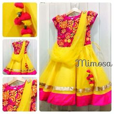 Yellow and pink frock  with a net stole running across the front to complete the traditional look