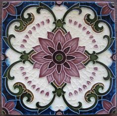 Terrific art nouveau design with gothic references in a fabulous seven glaze color combination depicting a central flower surrounded by scrolling vines and a sunburst of small hearts emanating from it....