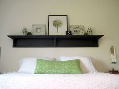 Remember to hang high, so we can sit up in bed against the wall... Happy At Home: Headboard Shelf Reveal