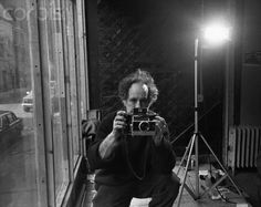 "Robert Frank. Go check out his photos from his ""the Americans"" project. Amazing amazing work."