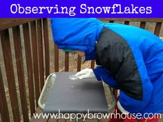 Observing snowflakes is a simple science activity for kids in the winter. Snowflakes and a magnifying glass.