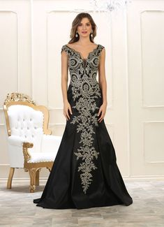 71c07ec3aaf91 This elegant floor length dress features cap sleeve with v back and  metallic lace applique. Perfect for prom