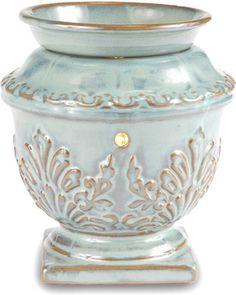 Warmer, Antique Finish ~ The wax warmer combines light, fragrance and artistic design to create a unique, personalized ambiance in any room. The soft 25W light provides a relaxing, decorative atmosphere while acting as a safe heat source to melt the wax cubes, which fill the room with a wonderful aroma.