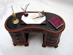 Kidney shaped Ornate writing desk Hand made from wood, the desk has carved detai. Kidney shaped Ornate writing desk Hand made from wood, the desk has carved detailing all around. Miniature Houses, Miniature Dolls, Miniature Furniture, Dollhouse Furniture, Tiny Office, Mini Library, Mini Doll House, Bjd, Tuscan Decorating