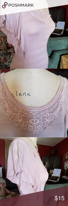 Soft Feminine Top Soft lavender almost mauve to the eyes. Beautiful lace around the neckline. Flowy side panels on the arms.  Although marked as a medium on the garment, it fits snug and I think would fit a small better, so I have listed it that way. Lavish Tops