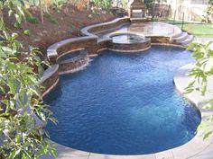 piscine enterrée en forme de rein et rond