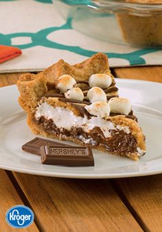 All it takes is one bite of this S'mores Pie from Inspired Gathering to fall in love. With a creamy chocolate and marshmallow filling and a crisp graham cracker crust, this dessert recipe is sure leave your guests wanting s'more of this delicious homemade treat.