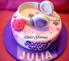 Birthday cake with headphones and pompons