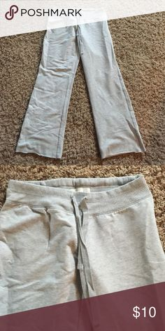Old Navy drawstring sweat pants Old Navy light gray sweat pants with draw string waist.  Boot cut with frayed hem.  56% cotton/ 38% polyester/ 6% spandex Old Navy Pants Track Pants & Joggers