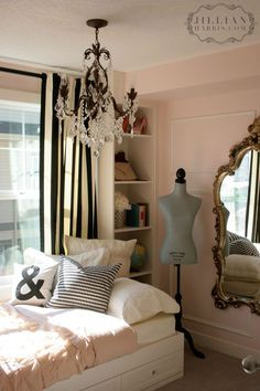 cute black and white striped curtains in a pink room with gold mirror + Chandeleir = paris feel - love for a big girl room.