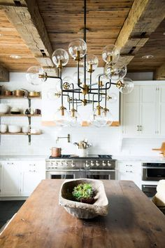 A BEAUTIFUL KITCHEN WITH A STUNNING CHANDELIER