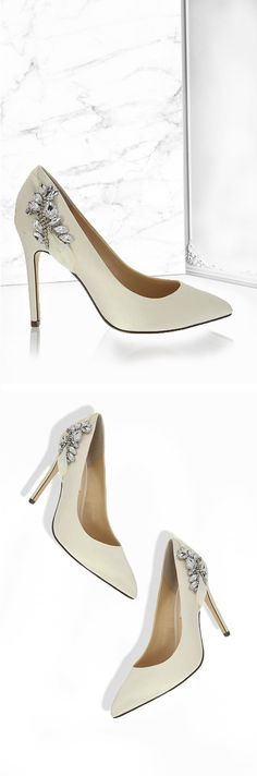 "Rhonae is a shimmering, crystal-embellished pump made in an ivory, crystal satin and features a 4"" heel 
