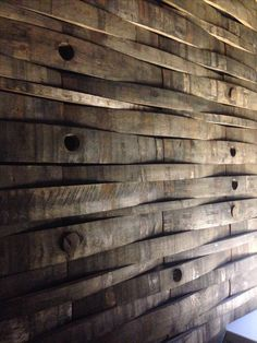 A wall made of whisky barrels.