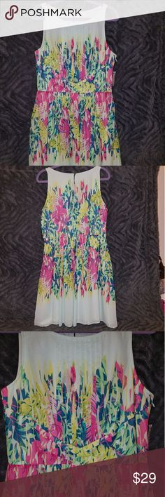Gorgeous Spring Dress Get ready for Spring with this Dress Barn, mint green and floral, pleated dress. Brand New w/ Tags!! Dress Barn Dresses Midi