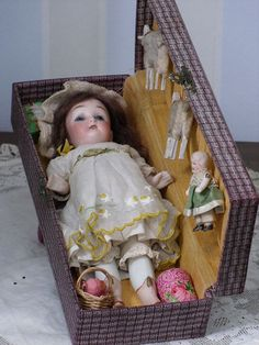 Vintage bisque doll with her own playthings in box... Lani, this would be a great idea for the doll from Grammy!