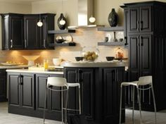 Traditional cabinets painted black will look much more updated. Great with Carrara marble looking countertops.