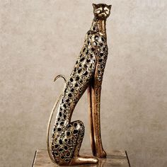 Sleek and graceful, the Wild Elegance Cheetah Sculpture will make a statement as it enhances your room's safari decor. The resin figure has openwork detailing that resembles the wild animal's spots. Elegant Home Decor, Elegant Homes, Unique Home Decor, Safari Decorations, Horseshoe Decorations, Bamboo Shades, Country Style Homes, Do It Yourself Home, Decorating Your Home