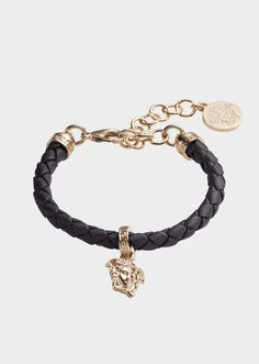 Versace Braided Leather Charm Bracelet for Women | Official Website. Braided leather charm bracelet with gold tone metal accents featuring a Medusa clip charm with lobster closure. All Versace Jewelry products are lead and nickel free. All the materials are hypoallergenic.