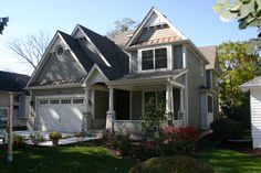 siding choices - lap - body, shake - gables, bumped out board and batten peaks