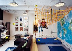Kid art on the wall? Check. Mini Thonet chairs and table? Check. Enormous map of the world? Check. Swings and climbing gym? Check.