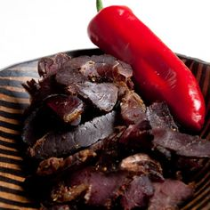 Making quality biltong in your biltong maker. Cut meat into strips, spice and hang the next day for perfect biltong. Yummy Snacks, Healthy Snacks, My Favorite Food, Favorite Recipes, Beef Jerky, Venison, Biltong, South African Recipes, Dehydrator Recipes