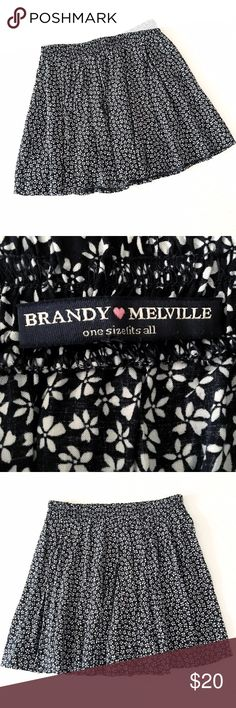 "brandy melville floral print mini skirt 58/42 cotton/viscose blend, laid flat measures 14"" long, 12"" across the waist UNstretched, approx 19"" fully stretched. No flaws to note, in gently worn condition. Color is navy and off white Brandy Melville Skirts Mini"