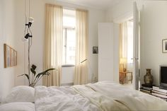 window treatments make sense of the tall ceilings