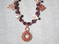 Twisted Copper Necklace with Purple Swarovski  Crystals by Wacknut, $99.00