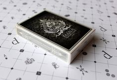 The Mana Deck (v1 oracle ed.) 2012.  A striking and truly beautiful all custom limited edition deck featuring the first intelligent use of metallic inks in playing card design.