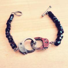 Handmade fashion bracelet made with handcuff charms.