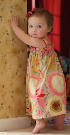 Funky Fabrix: Free Dress Tutorial from Sew Hip Mumma.. Thinking if you made straps a little longer with adjustable length via button and button holes...this dress could last a long time.