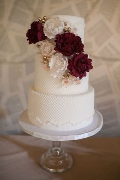 Three tier wedding cake creme and burgundy