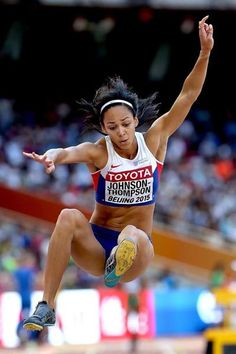 Katarina Johnson-Thompson in long jump qualifying at the IAAF World Championships, Beijing 2015 (Getty Images) Katarina Johnson Thompson, Jumping Poses, Heptathlon, Human Poses Reference, Pole Vault, Long Jump, Cool Poses, Olympic Athletes, Fitness Photoshoot