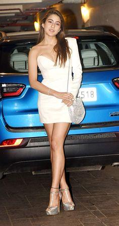 Sara Ali Khan attended Kareena Kapoor Khan's Christmas bash in Mumbai last night in a pristine white one-shoulder mini dress. Indian Bollywood Actress, Bollywood Actress Hot Photos, Indian Actress Hot Pics, Bollywood Girls, Beautiful Bollywood Actress, Most Beautiful Indian Actress, Bollywood Stars, Bollywood Fashion, Indian Actresses