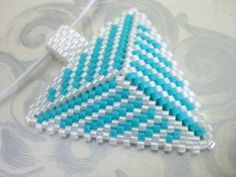 Peyote Triangle Pendant in White and Turquoise Seed Bead Beadwork. $21.00, via Etsy.