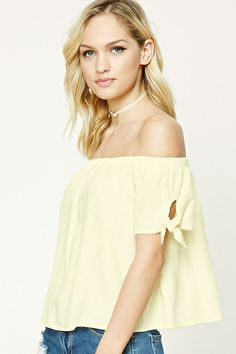 Forever 21 Contemporary - A woven top featuring an allover tonal geo-shaped pattern, an off-the-shoulder design, self-tie knotted short sleeves, an elasticized neckline, and a billowy silhouette.