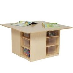 Wood Designs™ Cubby Table - This would be so easy to make with bookshelves (and a lot cheaper)