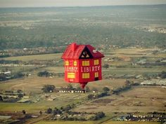 Amazing floating house spotted drifting through the skies over Melbourne yesterday - what can it mean?