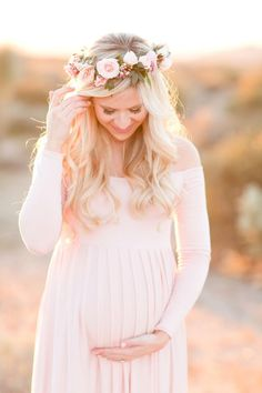 Gorgeous sunset desert maternity session. Blush rose floral crown. Blush off-the-shoulder full length dress for mamma to be. Soft blue sports jacket for dad. And stunning golden desert light. | amyandjordanblog.com