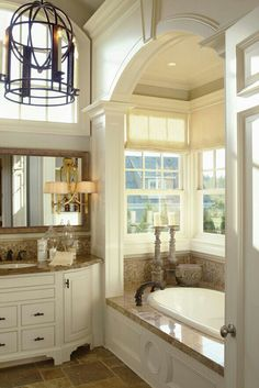 Lovely bathroom.Like dark chandelier,arch way,and lots of  windows..make it bright and beautiful!!