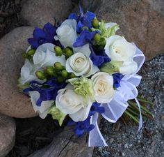 This bouquet would be perfect! Our colors being champaign navy blue and green