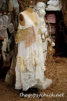 upcycle Deconstruct Old lace white dress has a very renaissance feel to it.