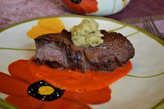 Beef fillet with red pepper coulis and avocado butter