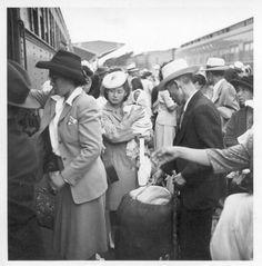 1940's. U.S. Japanese Americans being packed into trains on their way to internment.